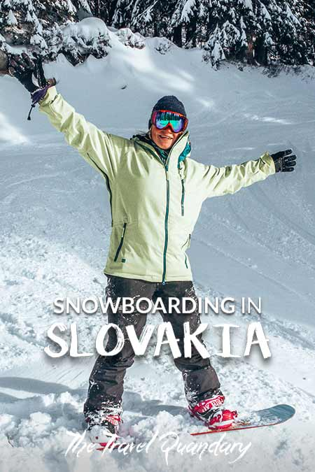 Bevan of the Travel Quandary stands on his snowboard with a victory pose, Jasna Resorts, Slovakia