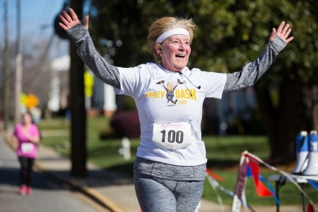 Nita Tammarine reacts as she crosses the finish line during the Dempsey Dash 5K, a race celebrating the memory of Brenau's longtime Executive Vice President and CFO Wayne Dempsey, on Saturday, March 11, 2017. (AJ Reynolds/Brenau University)