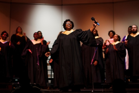 Brenau University Gospel Choir Director Portia Burns, WC '12, leads the mass choir performance in Brenau's Pearce Auditorium on Nov. 5, 2017. (AJ Reynolds/Brenau University)