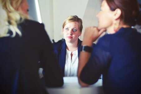 woman sitting for qualifying interview