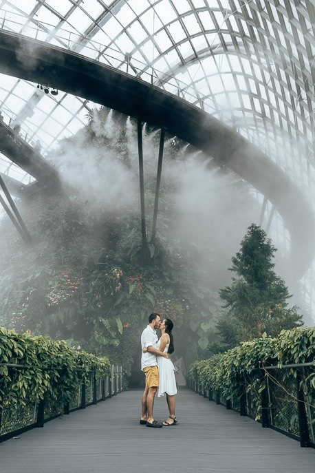 A couple kissing underneath the mist in the Cloud Forest, Gardens By The Bay Singapore