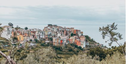 Admiring the view of the town of Manarola, Cinque Terre, Italy