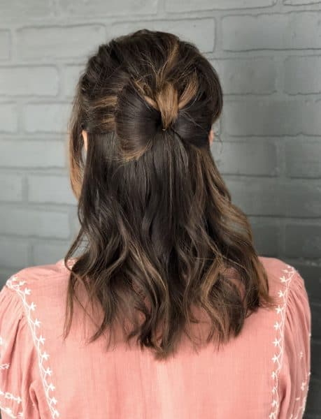 This hairstyle is all in the name. I just love the ease of this one, and I'm certain that you will as well! Not only is this look perfect for a casual night out, but it can easily be an elegant updo as well! Seriously, who doesn't want a bow tie made from their own hair? It's so simple and cute!