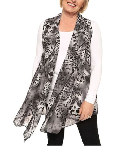 Asymmetrical vests are great at hiding the belly | 40plusstyle.com