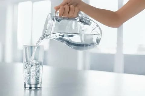 Drinking aplenty water for flat stomach.