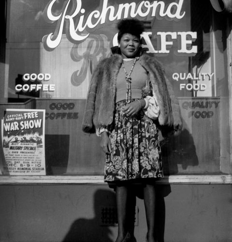 Woman standing in front of Richmond Cafe - Photo by Dorothea Lange. Printed by Seth Dickerman