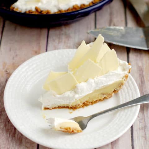 a slice of malted milk cream pie on a plate with a fork