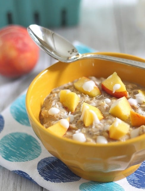 Stove top oatmeal with peaches and cream using coconut milk.