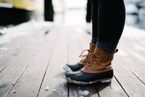 Girl wearing winter boots in canada