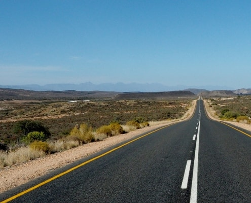 A road in South Africa stretches to the horizon