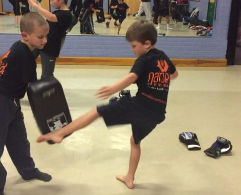 Two kids practicing Kung Fu