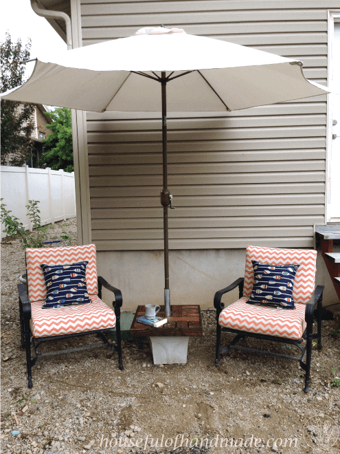 Make your own umbrella stand with a side table for cheap. Makes the perfect seating area to enjoy summer. Tutorial from Houseful of Handmade.