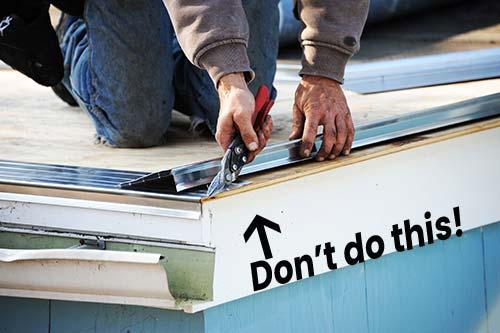 handyman installing drip edge incorrectly