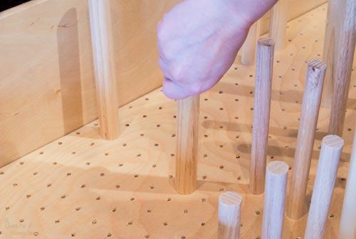 adding dowel pegs to dish drawer organizer