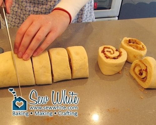 Cutting up the rolled Cranberry and cinnamon buns