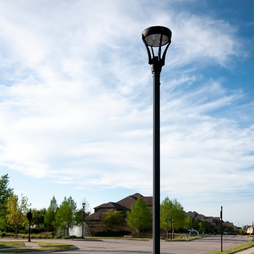 modern LED post lamp next to residential community road