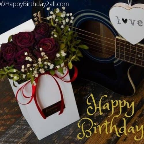 Happy Birthday wish with guitar and rose bouquet