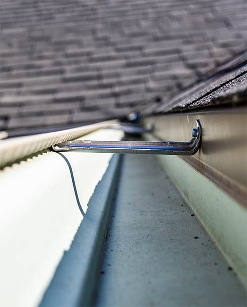 drip edge installed inside the gutter and behind the hangers