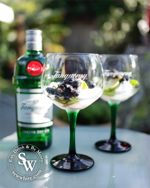 Tanqueray gin glasses and bottle of gin.