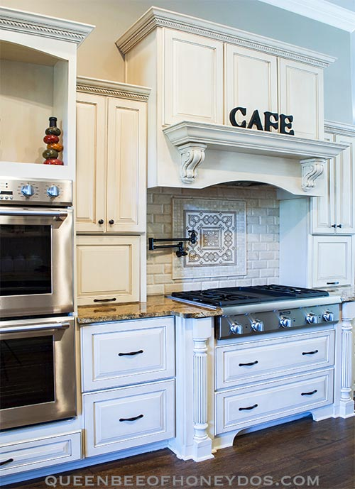 cooking center with range hood and cooktop