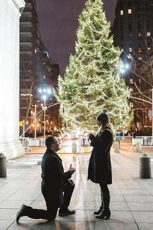 proposal under washington square christmas tree