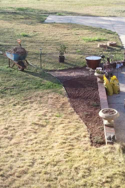 Removing turf from when creating new flower bed by digging it out with a flat shovel