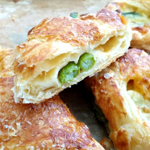 Close up of one puff pastry asparagus wrap cross-section.