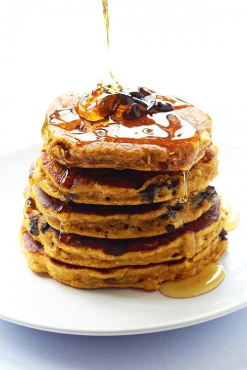 Pumpkin Spice Chocolate Chip Oatmeal Cookie Pancakes are easily whipped up in the blender. A heavenly way to eat dessert for breakfast with a seasonal pumpkin twist. It's quite healthy with no refined sugar and whole wheat flour.