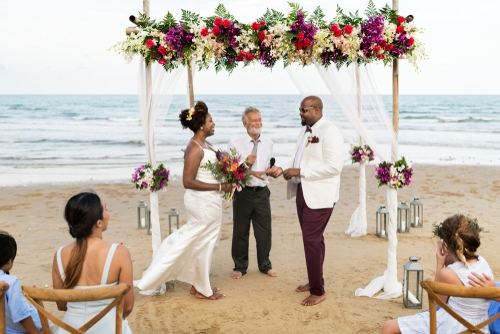 african american couple getting married by male wedding celebrant officiant
