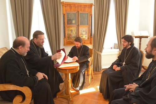 (from left) Archpriest Chad Hatfield, Archpriest John Behr, Metropolitan Hilarion, Hieromonk Ioann Kopeikin, and Priest Vladimir Shmaliy preparing to sign the cooperative agreement between St. Vladimir's Seminary and Ss. Cyril and Methodius Theological Institute.