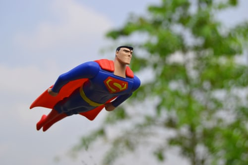 Superman flying is an image of a father. He is super to his family.