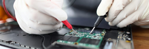 a person working on a printed circuit board