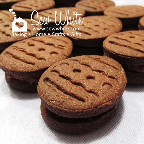 Chocolate Bourbon Biscuits stacked up with a chocolate filling.