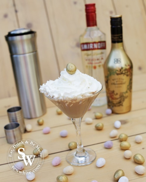 chocolate cocktail topped with cream and topped with a mini egg using Baileys luxe