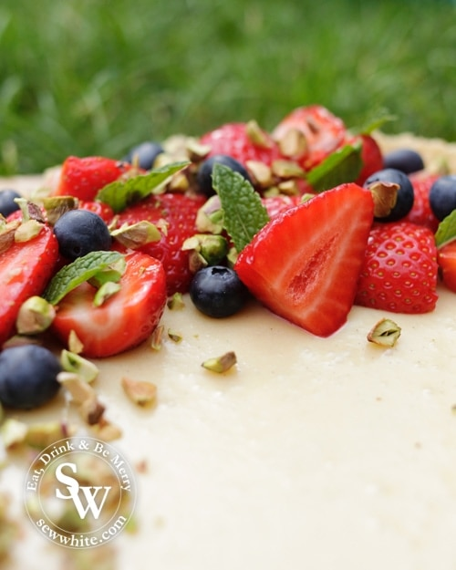 White Chocolate and Ginger Tart with Pistachios topped with fresh strawberries and blueberries