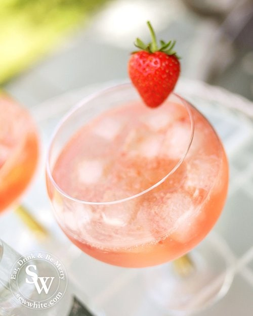 Sunset red gin and tonic made with Strawberry Jam and Whitley Neill Gin and Gallybird Tonic
