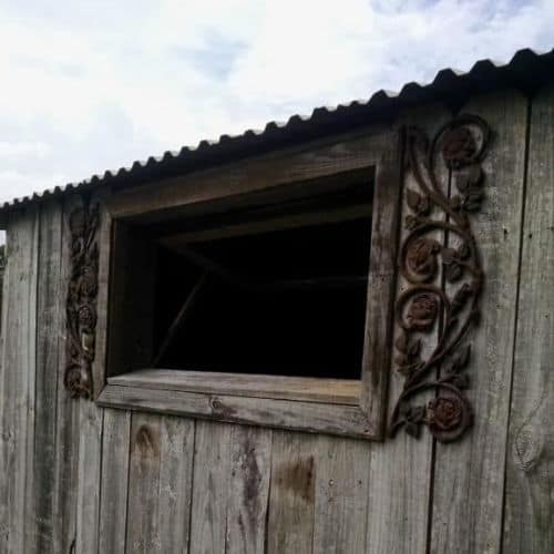 Barn with metal rose shutters