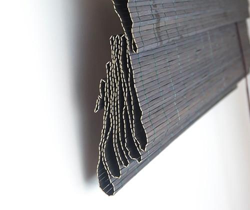 Bamboe vouwgordijn donkerbruin opgevouwen zijkant