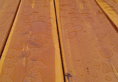 waterproofed wood - close up of wooden table sealed from water