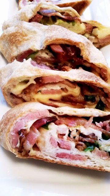 sliced loaded cheesy ham stromboli
