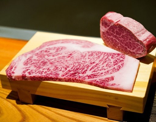 How to Cook a Wagyu Topside Roast. Two slices of wagyu meat, raw.