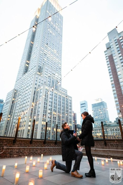 Photo Wedding proposal on a private rooftop with Empire State building view. | VladLeto