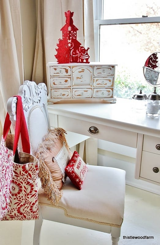 Tiny festive pillows add a Christmas touch to any room.