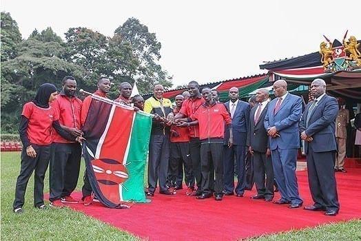 President Uhuru Kenyatta with members of the Kenyan team who will take part in the 2016 Olympics games in Rio de Janeiro. PHOTO | PSCU
