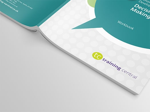 Close up image of cover spread of Training Central's Decision Making training materials workbook