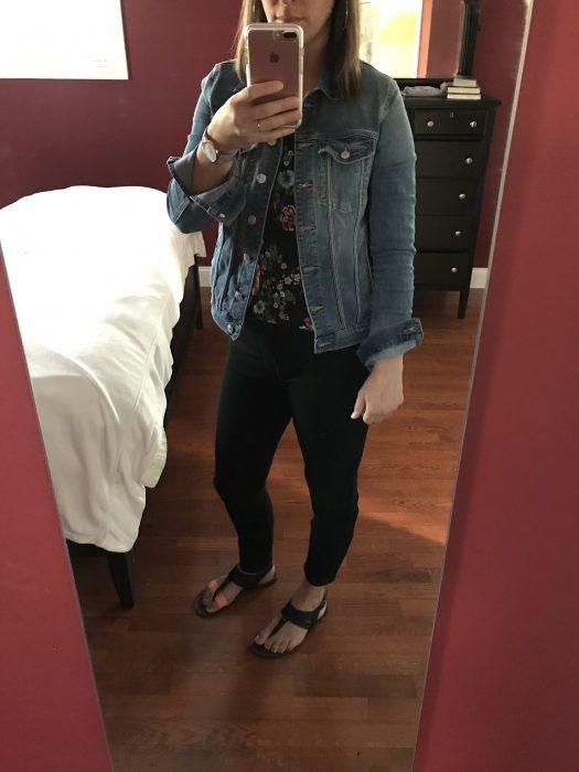 Kristen wearing jeans and a denim jacket.