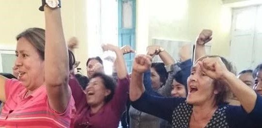 women at library cheering
