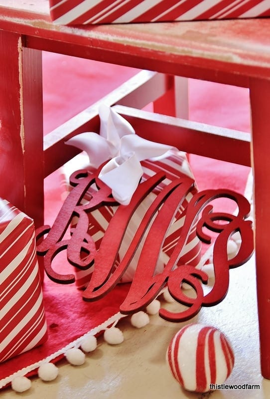 Monogrammed present toppers add a personalized holiday touch.