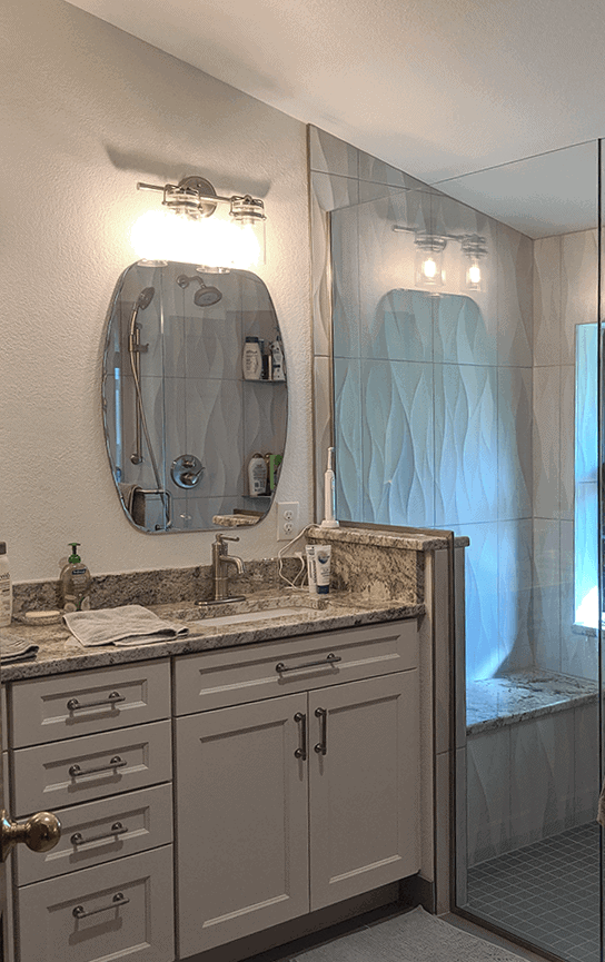 Littleton Co bathroom remodel with quartz counters, new vanity and glass shower