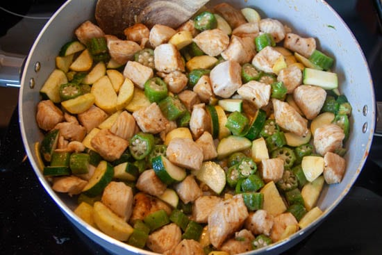 chicken, zucchini, and yellow squash in skillet